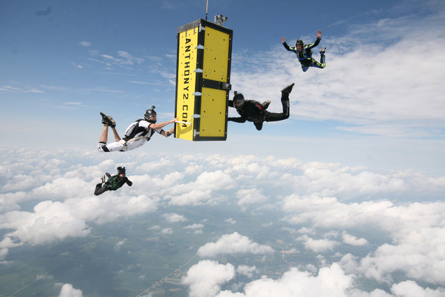 In this photo provided by Skydive Chicago, escape artist Anthony Martin falls while handcuffed and locked inside a box after being dropped from an airplane over Ottawa, Ill., Tuesday, Aug. 6, 2013. (Photo by Joe Silva/AP Photo/Courtesy of Skydive Chicago)
