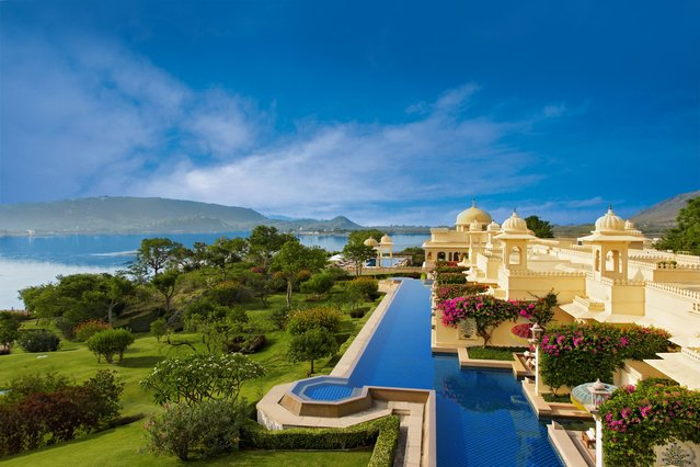 World's Greatest Swimming Pools: Oberoi Udaivilas, Udaipur, India. Blooming flowers. Manicured courtyards. An ornate Indian palace setting. Let the serene heated pool, lined with cobalt and light blue tiles, lure you into a calmer state of mind. For a splurge, book one of the four luxury suites, which come outfitted with a private 10-meter infinity pool and dining canopy. (At 1,150 square feet, they're also bigger than most New York apartments.) (From $357). (Photo by Oberoi Hotels & Resorts)