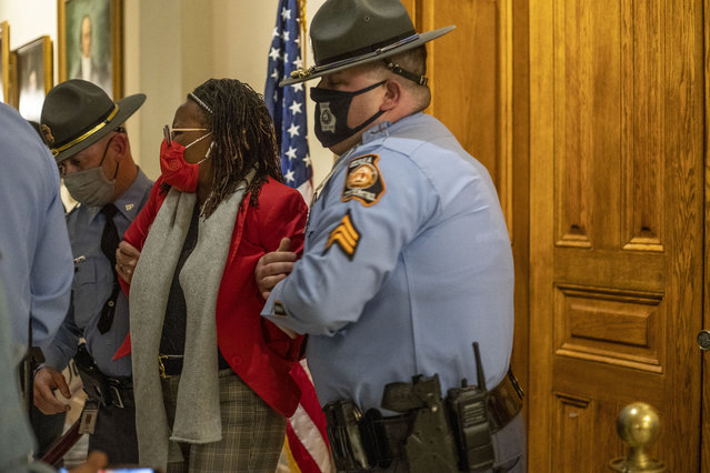 Rep. Park Cannon (D-Atlanta) is placed in handcuffs by Georgia State Troopers after being asked to stop knocking on a door that lead to Gov. Brian Kemp's office while Gov. Kemp was signing SB 202 behind closed doors at the Georgia State Capitol Building in Atlanta, Thursday, March 25, 2021. (Photo by Alyssa Pointer/Atlanta Journal-Constitution via AP Photo)