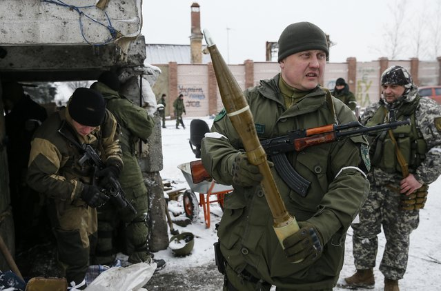 A pro-Russian separatist shows an anti-tank missile in the town of Vuhlehirsk, eastern Ukraine February 10, 2015. (Photo by Maxim Shemetov/Reuters)