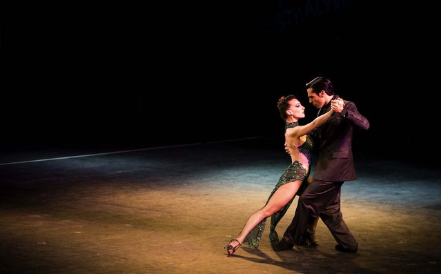 Debora Agudo and her dance partner Martin Barbadori perform during the 2013 Tango World Championship stage category in Buenos Aires, Argentina, on August 21, 2013. (Photo by Victor R. Caivano/Associated Press)