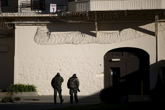 Two guards walk in a yard during a media tour of San Quentin State Prison in San Quentin, California December 29, 2015. (Photo by Stephen Lam/Reuters)