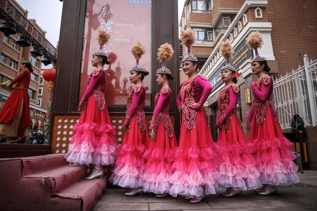 Dancers wait to perform at the International Grand Bazaar in Urumqi, western China's Xinjiang Uyghur Autonomous Region during a government organized trip for foreign journalists, 21 April 2021. With the population more than 3.5 million, Urumqi is the capital of the Xinjiang Uyghur Autonomous Region, which was a major hub on the Silk Road during China's Tang dynasty and developed its reputation as a leading cultural and commercial center during the Qing dynasty in the 19th century. Now, it became a regional transport node and a cultural, political and commercial center in western China. (Photo by Wu Hong/EPA/EFE)