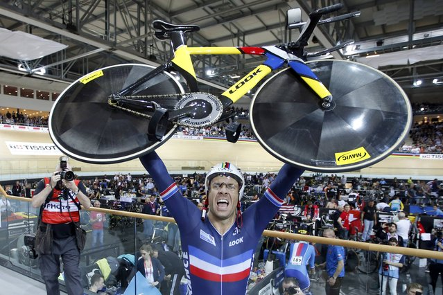 Francois Pervis of France reacts after winning the Men's 1km Time Trial final at the UCI Track Cycling World Cup in Saint-Quentin-en-Yvelines, near Paris, February 20, 2015. (Photo by Charles Platiau/Reuters)