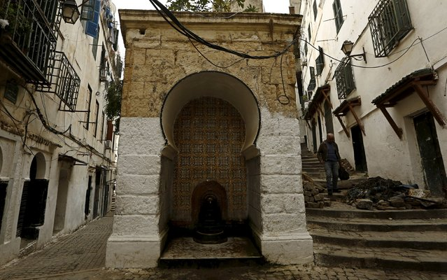 A man walks down an alley in the old city of Algiers Al Casbah, Algeria  December 3, 2015. (Photo by Zohra Bensemra/Reuters)
