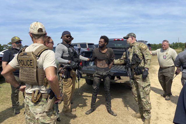 In this photo provided by the Chester County Sheriff's Office, Tyler Terry is arrested in South Carolina on Monday, May 24, 2021. A weeklong manhunt for Terry, a suspect wanted in the killings of four people, ended without another shot fired as hundreds of officers surrounded him, authorities said. (Photo by Chester County Sheriff's Office via AP Photo)