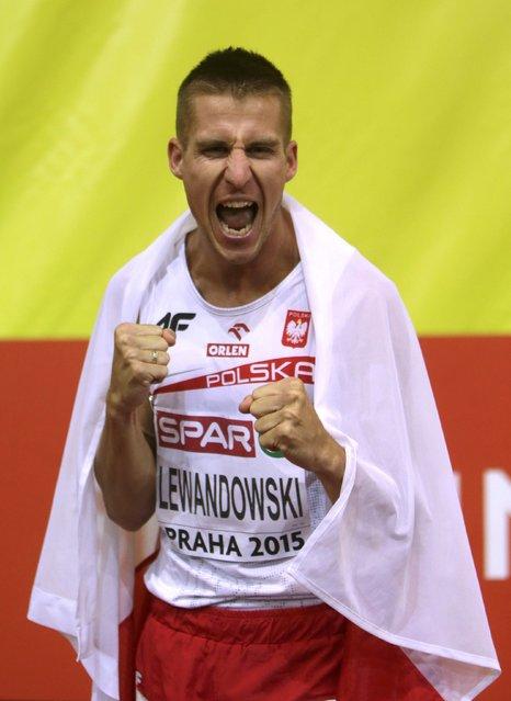 Marcin Lewandowski of Poland celebrates after winning the men's 800 metres final during the European Indoor Championships in Prague March 8, 2015. REUTERS/David W Cerny (CZECH REPUBLIC  - Tags: SPORT ATHLETICS)