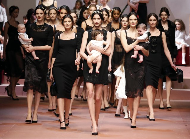 "Model Bianca Balti (2nd L) joins other models as they present creations from the Dolce & Gabbana Autumn/Winter 2015/16 collection during Milan Fashion Week in this March 1, 2015 file photo. British singer Elton John slammed Italian fashion duo Domenico Dolce and Stefano Gabbana on Sunday and called for a boycott of their brand after the pair championed ""traditional"" families. (Photo by Alessandro Bianchi/Reuters)"