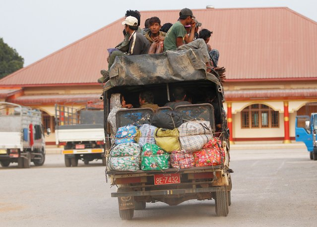 A vehicle carrying refugees from Laukkai arrives at temporary refugee camp in a monastery in Lashio February 19, 2015. Fighting broke out on February 9 between the army and a rebel force in the Kokang region of northeast Myanmar, on the border with China, called the Myanmar National Democratic Alliance Army (MNDAA). At least 50 government soldiers and 27 rebels have been killed, according to state media. (Photo by Soe Zeya Tun/Reuters)