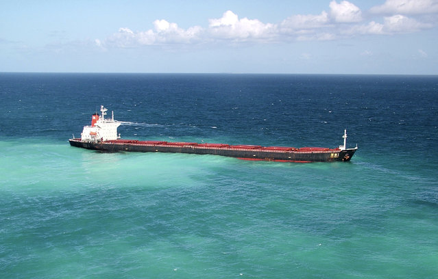 Oil is seen next to the 230-metre (754-ft) bulk coal carrier Shen Neng I about 70 km (43 miles) east of Great Keppel Island, April 4, 2010. The stranded Chinese bulk coal carrier leaked oil into the sea around Australia's Great Barrier Reef. (Photo by Maritime Safety Queensland/Reuters)