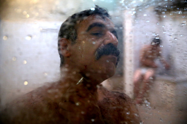 In this Friday, January 9, 2015 photo, a man shaves at the Ghebleh public bathhouse, in Tehran, Iran. (Photo by Ebrahim Noroozi/AP Photo)