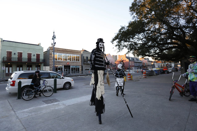 A member of the North Side Skull & Bone Gang dances in front of the Louis Armstrong park during the wake up call for Mardi Gras, Tuesday, February 9, 2016, in New Orleans. (Photo by Brynn Anderson/AP Photo)