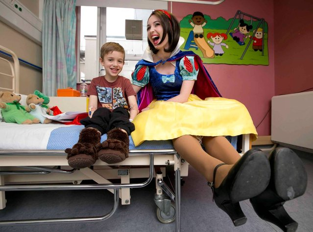 Temple Street Gaiety Pantomime. Cast members of this year's Gaiety Panto, Snow White and the Seven Dwarfs, Snow White (Megan Cassidy), Prince Valiant (David Glynn-Crowley) and Wanda (Rose Henderson) dropped into Temple Street Children's Hospital on November 27, 2013 to meet some patients. Pictured is Michael Muntean (aged 6) from Ashbourne, Co. Meath. (Photo by Leon Farrell/Photocall Ireland)