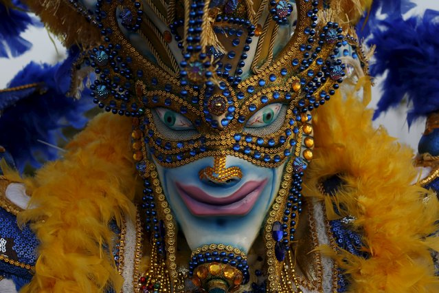 A reveller wearing a mask takes part in the last day of the annual Carnival parade in Panama City February 9, 2016. (Photo by Carlos Jasso/Reuters)