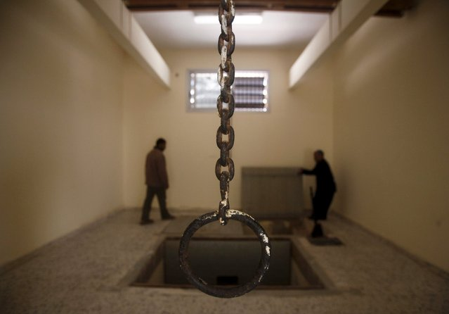 People inspect the execution room inside the main prison of late Libyan leader Muammar Gaddafi's forces in Benghazi February 28, 2011. (Photo by Suhaib Salem/Reuters)