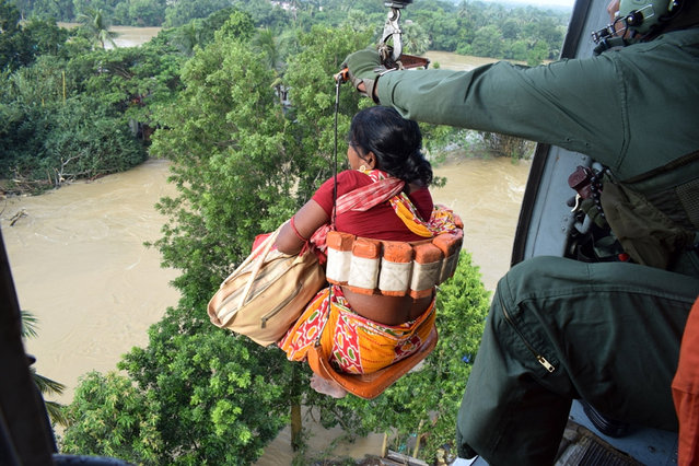A handout photo made available by the Indian Air Force (IAF) showing an IAF helicopters during the rescue operation in flood affected areas of Dhanyaghari of Khanakul in West Bengal, India, 02 August 2021. According to the IAF, helicopters of Indian Air Force rescued 31 people from rooftops and brought them to safety to Arambaug. The helicopters also dropped emergency food supplies in the affected areas after the torrential rain in the state has thrown life out of gear and created flood like situation in many districts. (Photo by Indian Air Force/Handout via EPA/EFE)