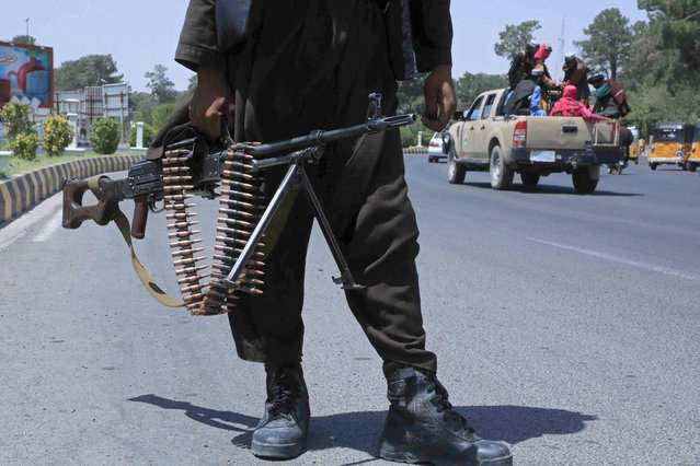 A Taliban fighter stands guard on a street in Herat on August 14, 2021. (Photo by AFP Photo/Stringer Network)