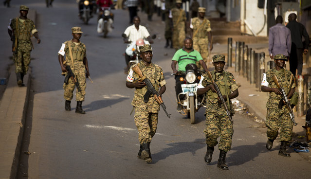 Ugandan army soldiers deploy, after the election result was announced, in downtown Kampala, Uganda, Saturday, February 20, 2016. (Photo by Ben Curtis/AP Photo)