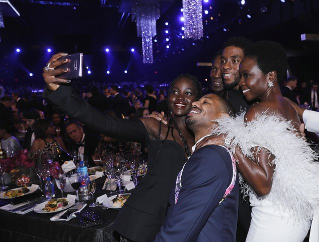 """""""Black Panther"""" movie cast members Lupita Nyong'o, Michael B. Jordan, Chadwick Boseman and Danai Gurira during the 25th Annual Screen Actors Guild Awards at The Shrine Auditorium on January 27, 2019 in Los Angeles, California. (Photo by Mike Blake/Reuters)"""
