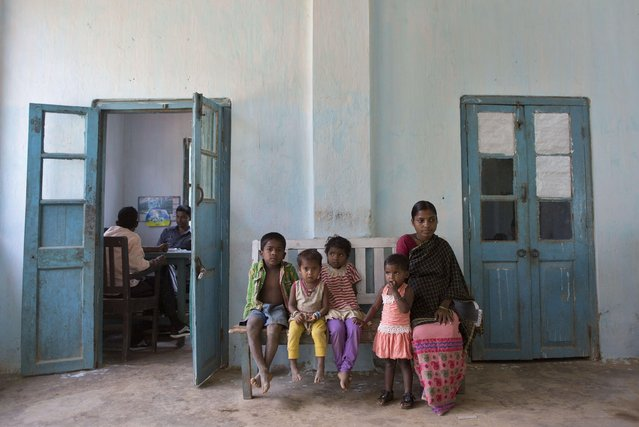 Golapi Supa Bhakat, 20, a pregnant woman, right, waits with her daughter, second right, for a health check at the garden hospital in Amchong on the outskirts of Gauhati, India, Tuesday, April 7, 2015. Tuesday marked World Health Day. (Photo by Anupam Nath/AP Photo)