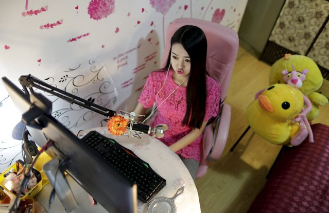 Online hostess Xianggong pouts as she gives a live broadcast in her bedroom in Beijing, February 10, 2015. (Photo by Jason Lee/Reuters)
