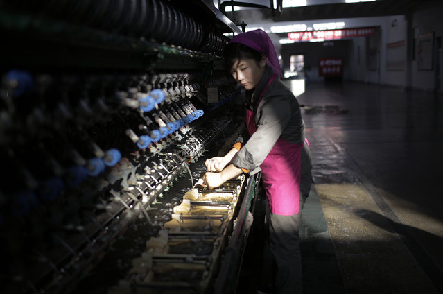 In this Friday, January 6, 2017, photo, a North Korean woman sorts out silkworm cocoons to be boiled later at the Kim Jong Suk Silk Mill in Pyongyang, North Korea. In his New Year's address, leader Kim Jong Un called on the North Korean people to step up production in order to raise the nation's standard of living, which is among the lowest in Asia. Kim himself visited the silk mill in early January. (Photo by Wong Maye-E/AP Photo)