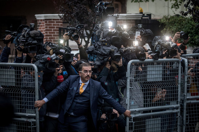 Photo of the year nominee: the disappearance of Jamal Kashoggi, by Chris McGrath. An unidentified man tries to hold back the press as Saudi investigators arrive at the Saudi Arabian consulate in Istanbul, Turkey, amid a growing international backlash against the murder of the journalist Jamal Khashoggi. (Photo by Chris McGrath/Getty Images/World Press Photo 2019)