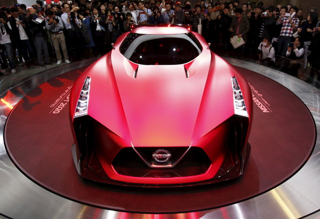 Visitors take pictures of Nissan Motor Co's concept car Nissan Concept 2020 Vision Gran Turismo displayed at the 44th Tokyo Motor Show in Tokyo, Japan Monday, November 2, 2015. (Photo by Issei Kato/Reuters)