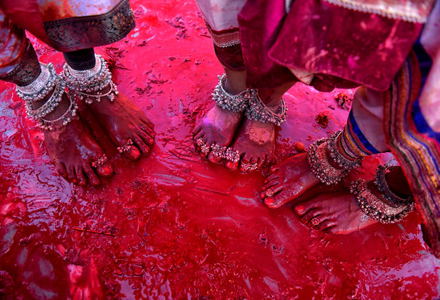 Colorful Legs of Transgenders seen on the ground of Radharani Temple after completion of Holi celebration at Nandgaon, Uttar Pradesh, India on March 16, 2019. Holi Festival of India is one of the biggest Holi celebration in India as many Tourists and devotees gather to observe this colourful programme. (Photo by Avishek Das/SOPA Images/LightRocket via Getty Images)