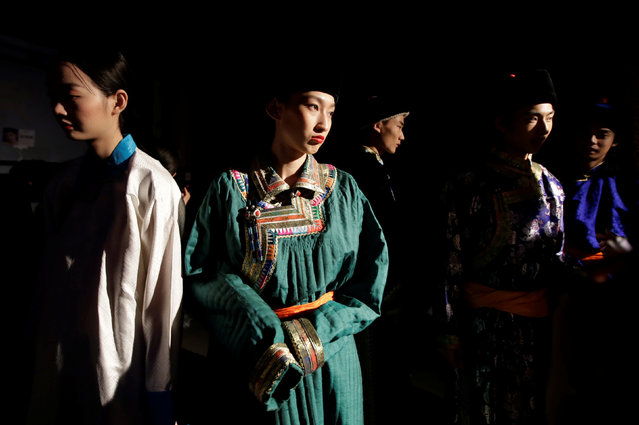 Models prepare backstage before Eji's pastoral song Autumn/Winter collection show during the China Fashion Week in Beijing, China, March 27, 2019. (Photo by Jason Lee/Reuters)