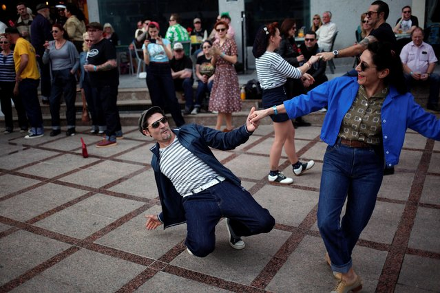 People dressed in fifties-style outfits dance during the 23rd Rockin' Race Jamboree International Festival in downtown Torremolinos, near Malaga, southern Spain February 4, 2017. (Photo by Jon Nazca/Reuters)