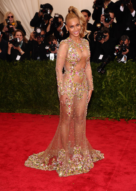 "Beyonce arrives at The Metropolitan Museum of Art's Costume Institute benefit gala celebrating ""China: Through the Looking Glass"" on Monday, May 4, 2015, in New York. (Photo by Charles Sykes/Invision/AP Photo)"
