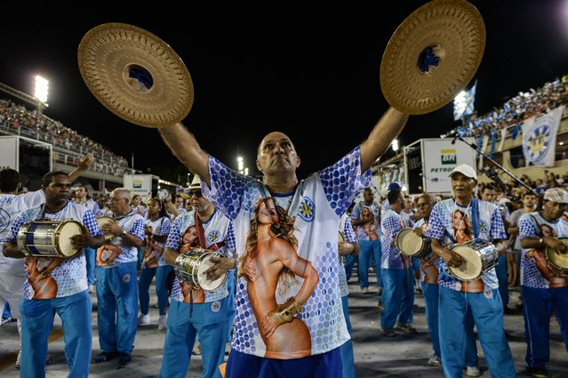 Members of last year's winner Unidos de Vila Isabel samba school dance during the final technical reheasal at the Sambodromo in Rio de Janeiro, Brazil on Februrary 23, 2014. The peak of Rio's carnival will be on March 2 and 3, 2014. (Photo by Yasuyoshi Chiba/AFP Photo)