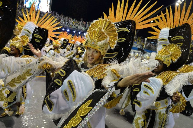 Revelers of the Vai-Vai samba school perform during the first night of carnival parade at the Sambadrome in Sao Paulo, Brazil on March 01, 2014. (Photo by Nelson Almeida/AFP Photo)