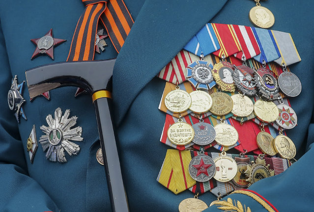 Medals are seen on a veteran's jacket during the Victory Day parade, which marks the anniversary of the victory over Nazi Germany in World War Two, in Red Square in central Moscow, Russia May 9, 2019. (Photo by Maxim Shemetov/Reuters)
