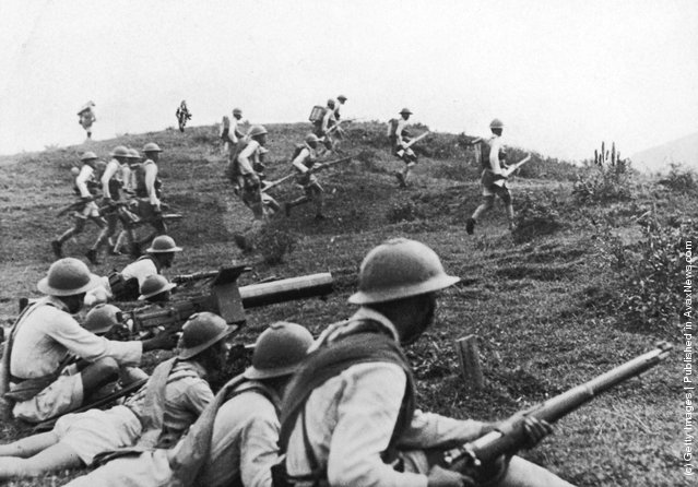 The Kwantung army (Chinese) rushing to the front lines, five miles south-east of Waichon. The Japanese occupied the town on 15th October 1938