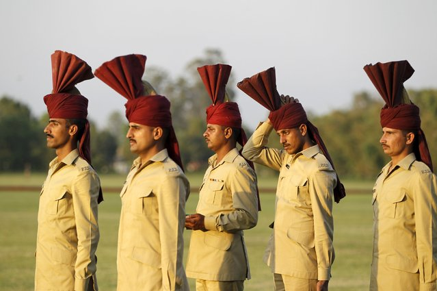 A member of the ceremonial guard adjusts his headgear during the finals of the Murree Brewery Cup polo tournament in Rawalpindi April 12, 2015. (Photo by Caren Firouz/Reuters)