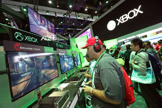 E3 2015 attendees get hands on with Gears of War Ultimate Edition at the Xbox booth at E3 in Los Angeles on Tuesday, June 16, 2015. (Photo by Casey Rodgers/Invision for Microsoft/AP Images)