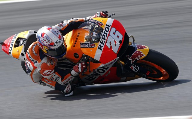 Spanish Moto GP rider Dani Pedrosa steers his bike during the free practice for the motorcycle GP in Montmelo, Spain, Saturday, June 13, 2015. The Catalunya Grand Prix will take place on Sunday in Montmelo. (AP Photo/Manu Fernandez)
