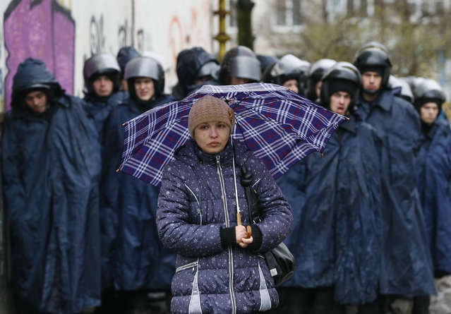 A supporter of the detained pro-Russian protesters waits in front of the court building in Kharkiv, April 10, 2014. Ukraine will not prosecute pro-Russian separatists who seized government buildings if they surrender their weapons and disperse, the country's president said on Thursday, in a bid to ease a crisis that stoked fears of the country's break-up. (Photo by Gleb Garanich/Reuters)