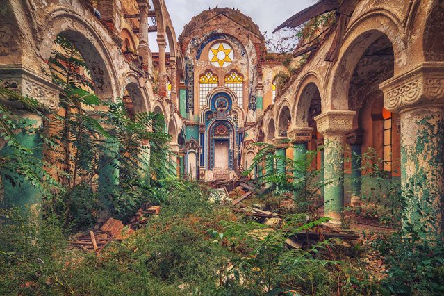 These illuminating images show the crumbling remains of some of the worlds places of worship. The shots include golden chapels, overgrown synagogues and eerily silent rooms that were once used for prayer. They were visited by Matthias Haker, a 31-year-old photographer from Potsdam, Germany. Adding to the general intrigue of his images, Matthias never discloses the location of a shot – not even the town, country or continent. Here: The Old Synagogue. (Photo by Matthias Haker/Caters News)
