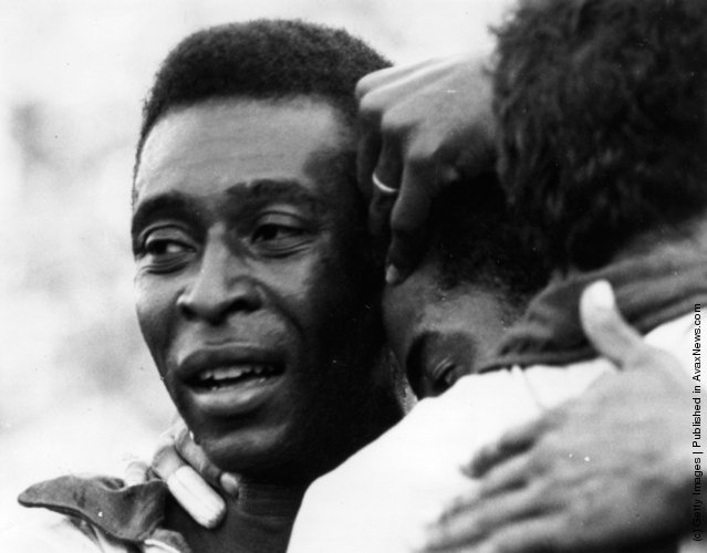 1970: Brazilian soccer star Pele weeps with joy in the arms of his team-mates after Brazil won the FIFA World Cup at the Estadio Azteca in Mexico City, beating Italy 4-1