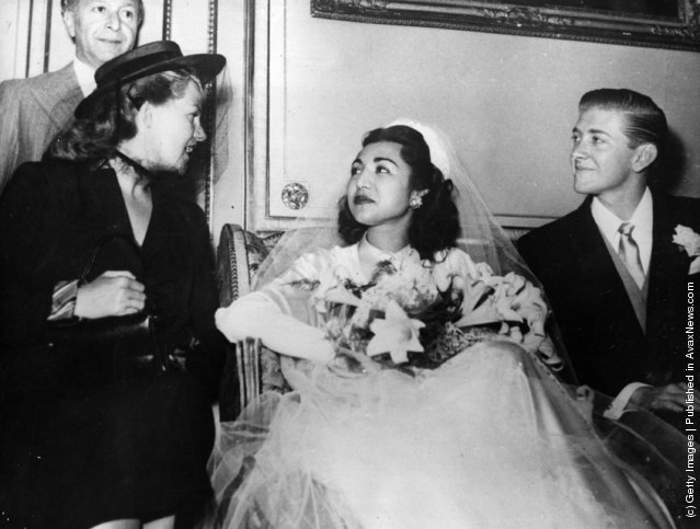 1950:  Princess Fatima of Persia and her bridegroom, American University graduate, Vincent Les Hillyer, at their Muslim wedding ceremony at the Persian Embassy in Paris. On the right is American film actress and dancer Rita Hayworth (1918 - 1987), Princess Aly Khan (born Margarita Carmen Cansino)