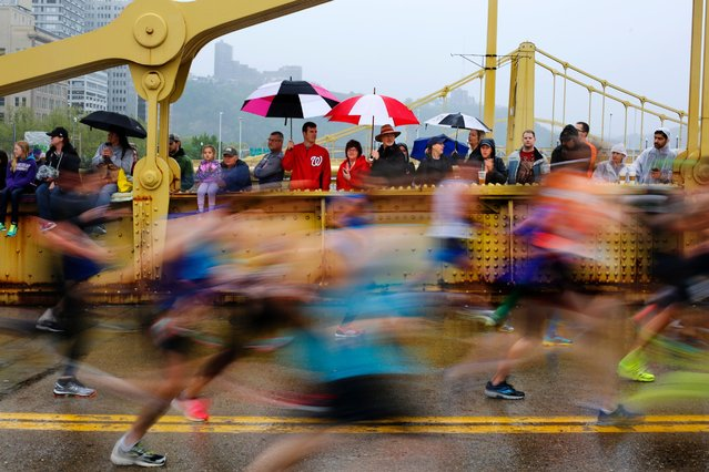 Spectators gather on the Andy Warhol bridge over the Allegheny River in downtown Pittsburgh to watch the over 35,000 runners participating in the 2016 Pittsburgh Marathon and 1/2 Marathon, May 1, 2016. (Photo by Gene J. Puskar/AP Photo)