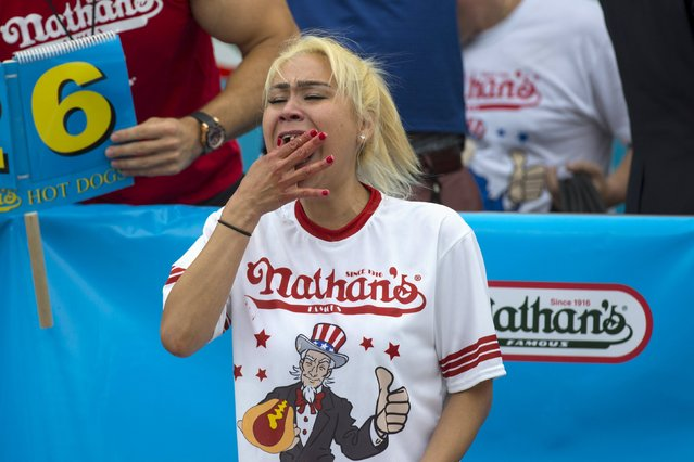 Miki Sudo, winner of Nathan's Famous Hot Dog Eating Contest in the Women's division, eats a hot dog during the competition in Brooklyn, New York July 4, 2015. Sudo finished with a total of 38 hot dogs consumed in ten minutes. (Photo by Andrew Kelly/Reuters)