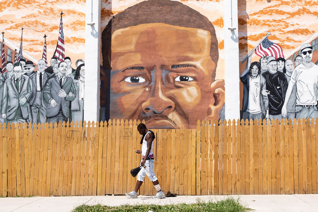 """A pedestrian walks past a mural dedicated to Freddie Gray, near the site where he was beaten by police in 2015 in western Baltimore, Maryland, USA, 29 July 2019. Freddie Gray was a citizen who died from injuries inflicted by Baltimore police. Over the weekend Trump doubled-down on social media comments he made disparaging Democratic Representative from Maryland Elijah Cummings and the city of Baltimore, which he said is a """"rat and rodent infested mess"""". Trump's comments have been widely dismissed by Democrats as offensive. (Photo by Michael Reynolds/EPA/EFE)"""