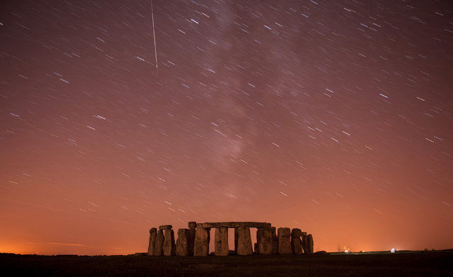 Stonehenge: A meteor streaks past stars in the night sky over Stonehenge in Salisbury Plain, southern England August 12, 2010. (Photo by Kieran Doherty/Reuters)