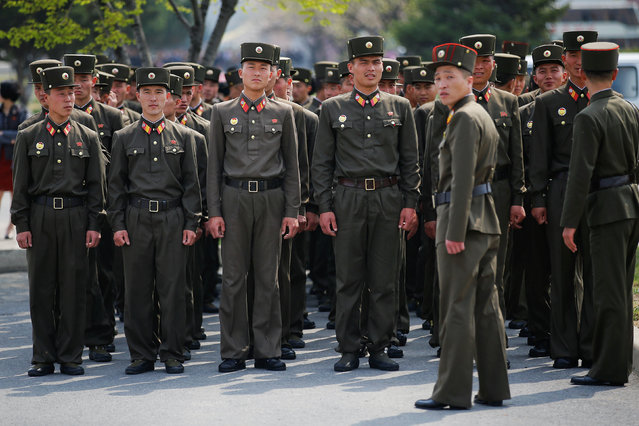 Soldiers arrive to visit the flower exhibition marking the 105th birth anniversary of the country's founding father, Kim Il Sung in Pyongyang, North Korea April 16, 2017. (Photo by Damir Sagolj/Reuters)