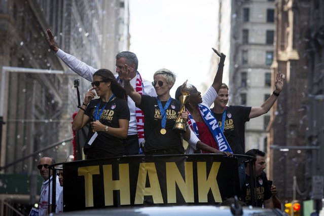 The U.S. women's soccer team cheer during the ticker tape parade to celebrate their World Cup final win over Japan on Sunday, in New York, July 10, 2015. (Photo by Andrew Kelly/Reuters)