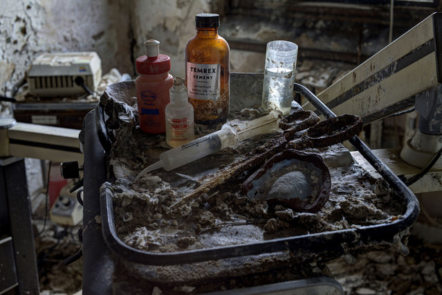 Dental equipment left behind in an asylum, New Jersey. (Photo by Daniel Barter/Caters News)